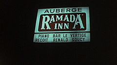 Canada 1975: hotel and restaurant signs at night - stock footage