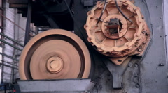Iron and Steel factory automative equipment. Gear spinning - stock footage