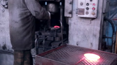 Mining and metal forging factory. Worker operates with automated Metalworking Stock Footage
