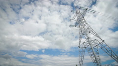 High voltage tower with cloudy sky background Stock Footage