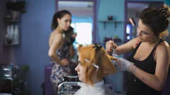 Professional hair color salon. Pretty and smiling girl came to her stylist - stock footage