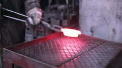 Mining and metal forging factory. Worker operates with automated Metalworking - stock footage
