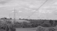 High-voltage power line in the ladscape - stock footage