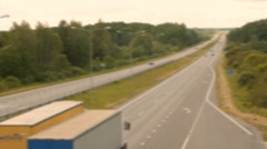 A lot of trucks and cars move on road. Blurr Stock Footage