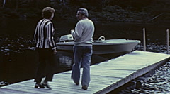 Canada 1975: people boarding a motorboat - stock footage