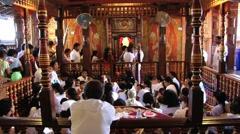 People take part in religious ceremony in the Temple of Tooth, Kandy, Sri Lanka. Stock Footage