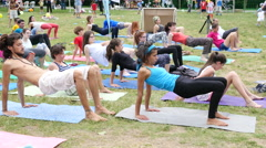 Healthy lifestyle family festival - park grass yoga train exercise workout Stock Footage