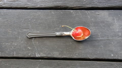 Bio food idea, spoon with a cherry and text Stock Footage