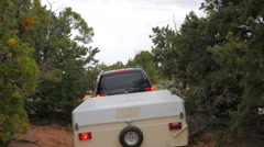 Pop up camp trailer on a sandy dirt road Stock Footage