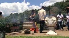 People burn incense at the Temple of Tooth in Kandy, Sri Lanka. Stock Footage