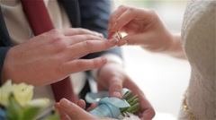 Groom and bride exchange wedding rings, newlyweds exchange rings Stock Footage
