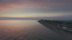 Aerial Flying over the beach at sunset Stock Footage