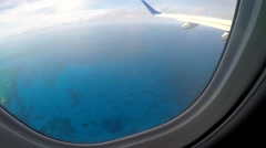 Aerial view from the airplane to the Ocean Stock Footage