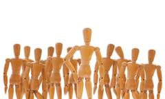 Character standing in front of a crowd - stock photo