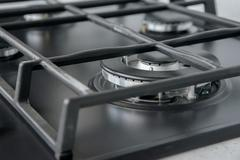 New and modern shining metal gas cooker Stock Photos