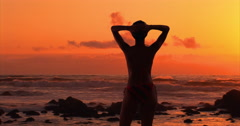 Sexy black woman in striped swimsuit enjoying sunset at beach Stock Footage