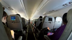 Passengers in the airplane cabin during flight (Embraer 190 craft). Stock Footage