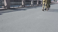 View of running male and female feet in military uniform on asphalt. Woman on - stock footage