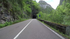 Driving POV countryside green forest mountain tunnel canyon Asturias Spain 4k - stock footage