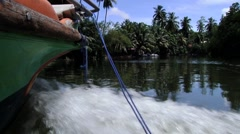 Tourist boat moves by the Madu Ganga river in Sri Lanka. Stock Footage