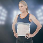 Female athlete standing with hand on hip against composite image of spotlight - stock photo
