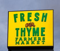 Fresh Thyme Farmers Market Exterior and Logo - stock photo