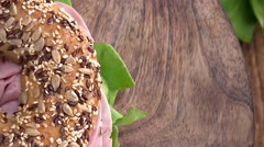 Portion of Bagel with Ham (seamless loopable; 4K) Stock Footage