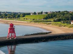 Lighthouse at harbor of Newcastle, England - stock photo
