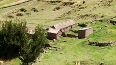 Landscape with grassland and farms in Andes in Peru Stock Footage