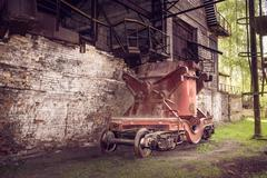 Old steel buckets to transport the molten iron - stock photo