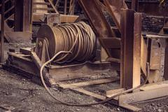 Old metal cable in blast furnace workshop - stock photo