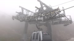 Gondola lift pass by intermediate pylon, close up wheels and haul steel cable Stock Footage