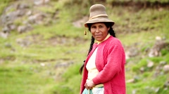 Woman spinning wool in Andes of Peru, South America Stock Footage