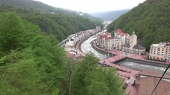 Roza Khutor city hall and square from above, green mountain slopes Stock Footage