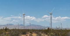 Tehachapi wind farm in desert near mountains time lapse 4K Stock Footage