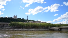 Soane river view with cathedrals Saint-Georges and Fourviere under blue sky. Stock Footage