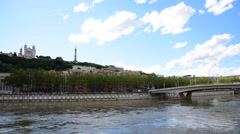 Soane river view with cathedrals Saint-Georges and Fourviere under blue sky whit Stock Footage