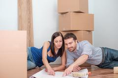 Young couple joyful during renovation and relocation home time Stock Photos
