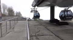 Cable cars move to and from station, POV look from side platform Stock Footage