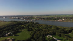 Petrochemical factory and a river in the Netherlands aerial shot with a drone Stock Footage