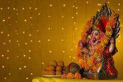 Ganesh idol and laddus Stock Photos