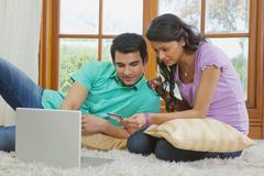 Couple making online transaction Stock Photos