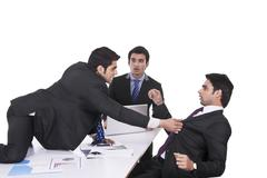 Businessman getting violent with fellow businessman Stock Photos