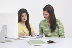 Elder sister teaching younger sister Stock Photos