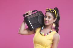 Portrait of woman with cassette player Stock Photos