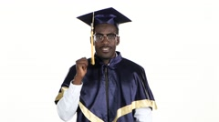 Black man in dressed for graduation. White. Close up Stock Footage