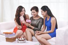 Young women celebrating a birthday Stock Photos