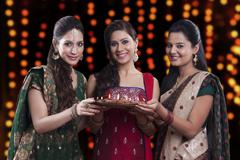 Young women celebrating Diwali Stock Photos