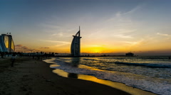 The twilight at the Burj Al Arab and the Jumeirah beach in Dubai, UAE Stock Footage
