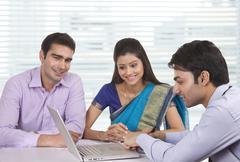 Couple sitting with financial advisor Stock Photos